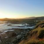 Sonnenuntergang über der Curio-Bay III (noch ein Fotograf im Gras)